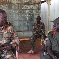 This photo of Saturday, April 14, 2012,  shows Sudan Peoples Liberation Army (SPLA) troops at their position in the Unity Oil Field near to the front lines at Heglig, South Sudan. Two Sudanese Sukhoi fighters dropped 6 bombs in the Bentiu area, killing five and wounding four others.