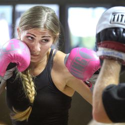 Boxer Whitney Gomez works with trainer Nick Butterfield at Fullmer Brothers Boxing Gym in South Jordan on Wednesday, June 7, 2017.