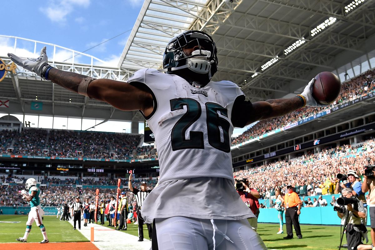 Philadelphia Eagles running back Miles Sanders scores a touchdown in the first half against the Miami Dolphins at Hard Rock Stadium.
