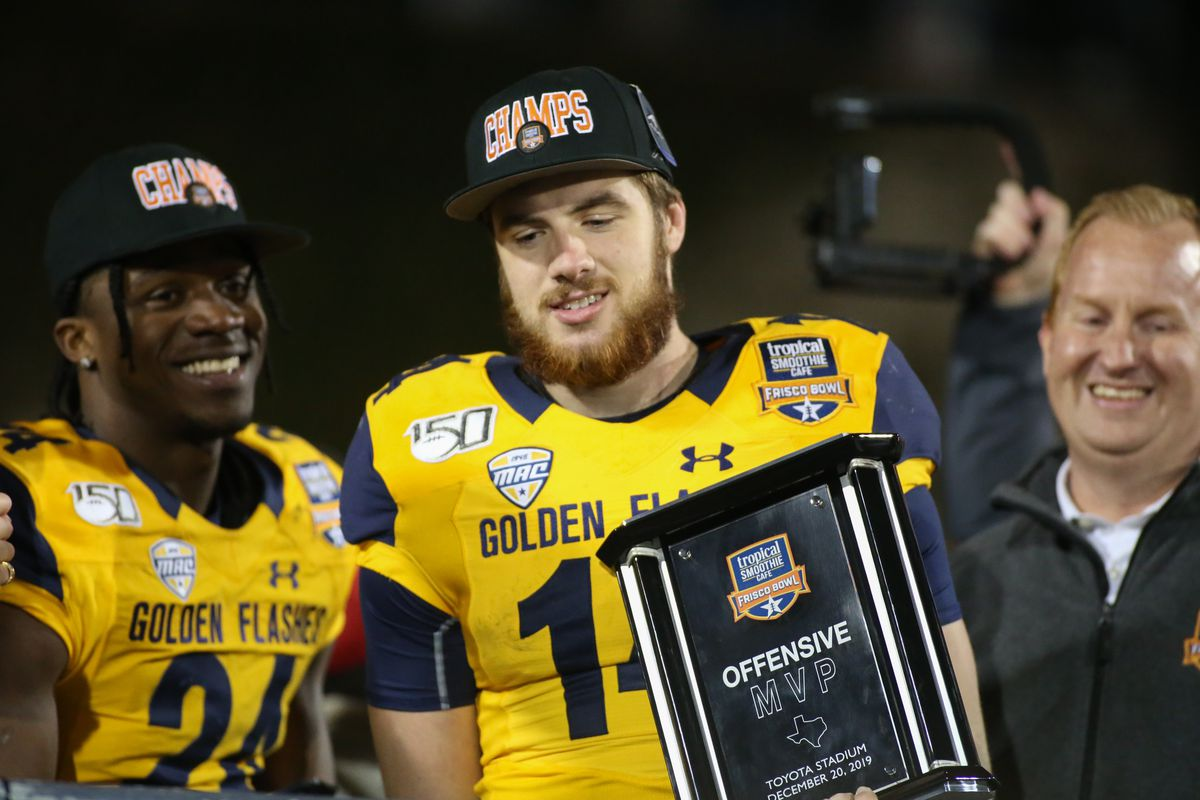 Kent State Golden Flashes quarterback Dustin Crum (14) is awarded the offensive MVP award after winning the Tropical Smoothie Cafe Frisco Bowl on December 20, 2019 at Toyota Stadium in Frisco, TX.