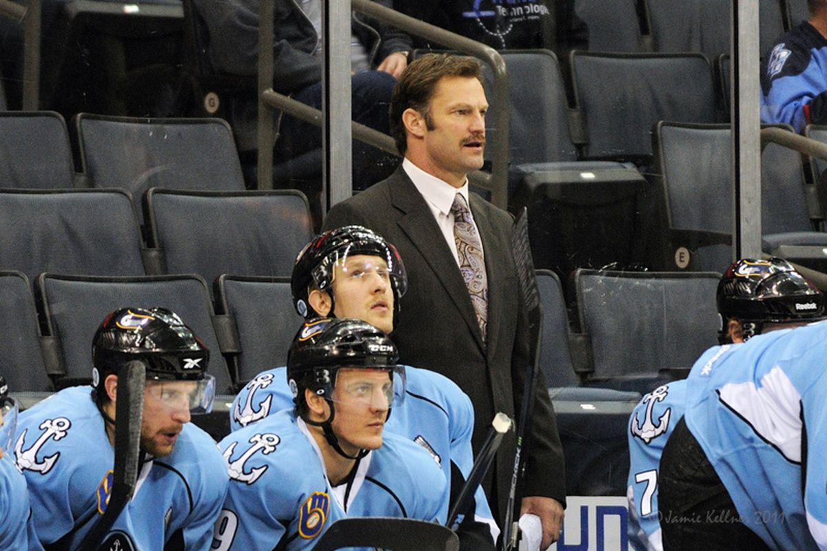 """Kirk Muller in Charlotte yesterday behind the bench of the Checkers opponents, the Preds' affiliate Milwaukee Admirals. Photo via <a href=""""http://farm8.staticflickr.com/7149/6418903421_8aff6f298b_b.jpg"""">Jamie Kellner</a>"""