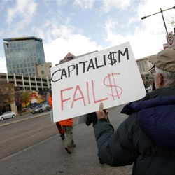 Occupy SLC participants rally to protest the arrests made in Salt Lake City  Sunday, Nov. 13, 2011.