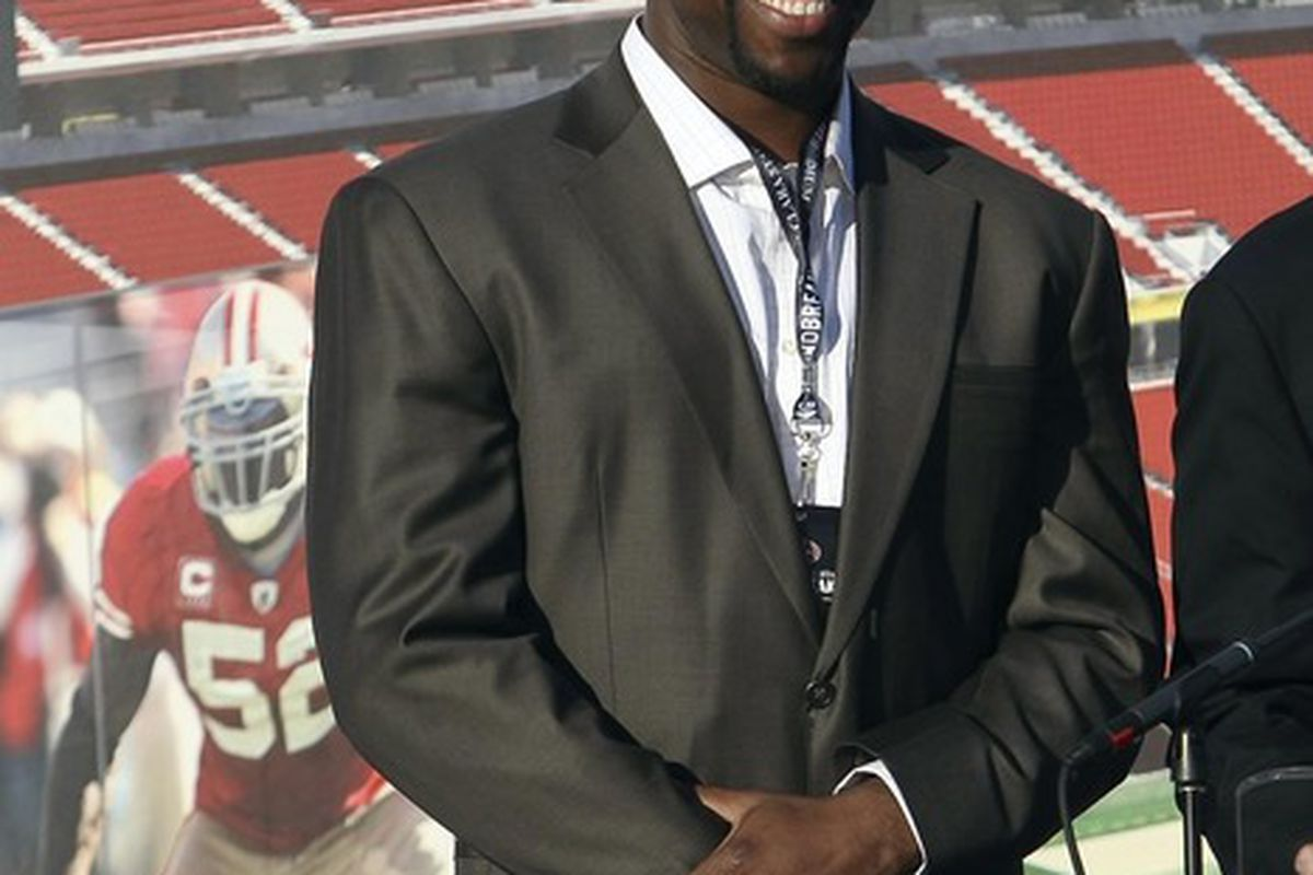 April 19, 2012; Santa Clara, CA, USA; San Francisco 49ers tight end Vernon Davis smiles during the groundbreaking ceremony at the site of the new 49ers stadium. Mandatory Credit: Kelley L Cox-US PRESSWIRE