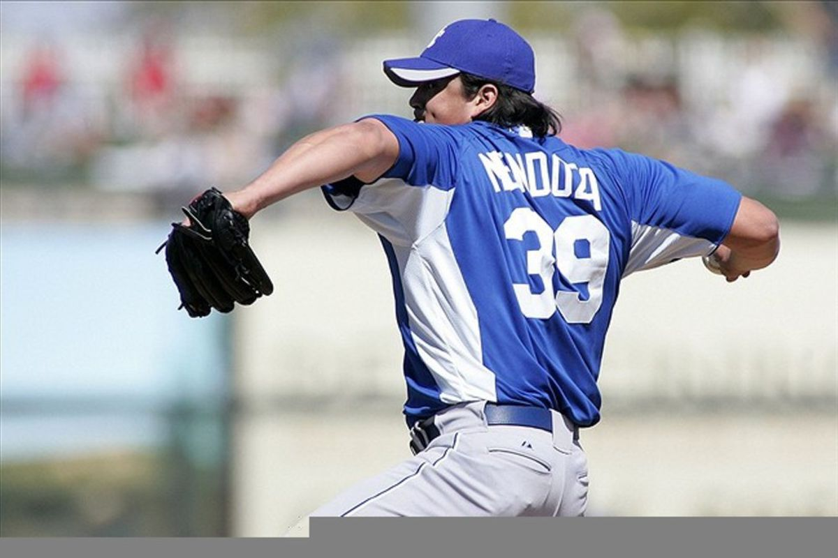 Mar 4, 2012; Surprise, AZ, USA; Kansas City Royals starting pitcher Luis Mendoza (39) pitches against the Texas Rangers during the second inning at Surprise Stadium.  Mandatory Credit: Jake Roth-US PRESSWIRE