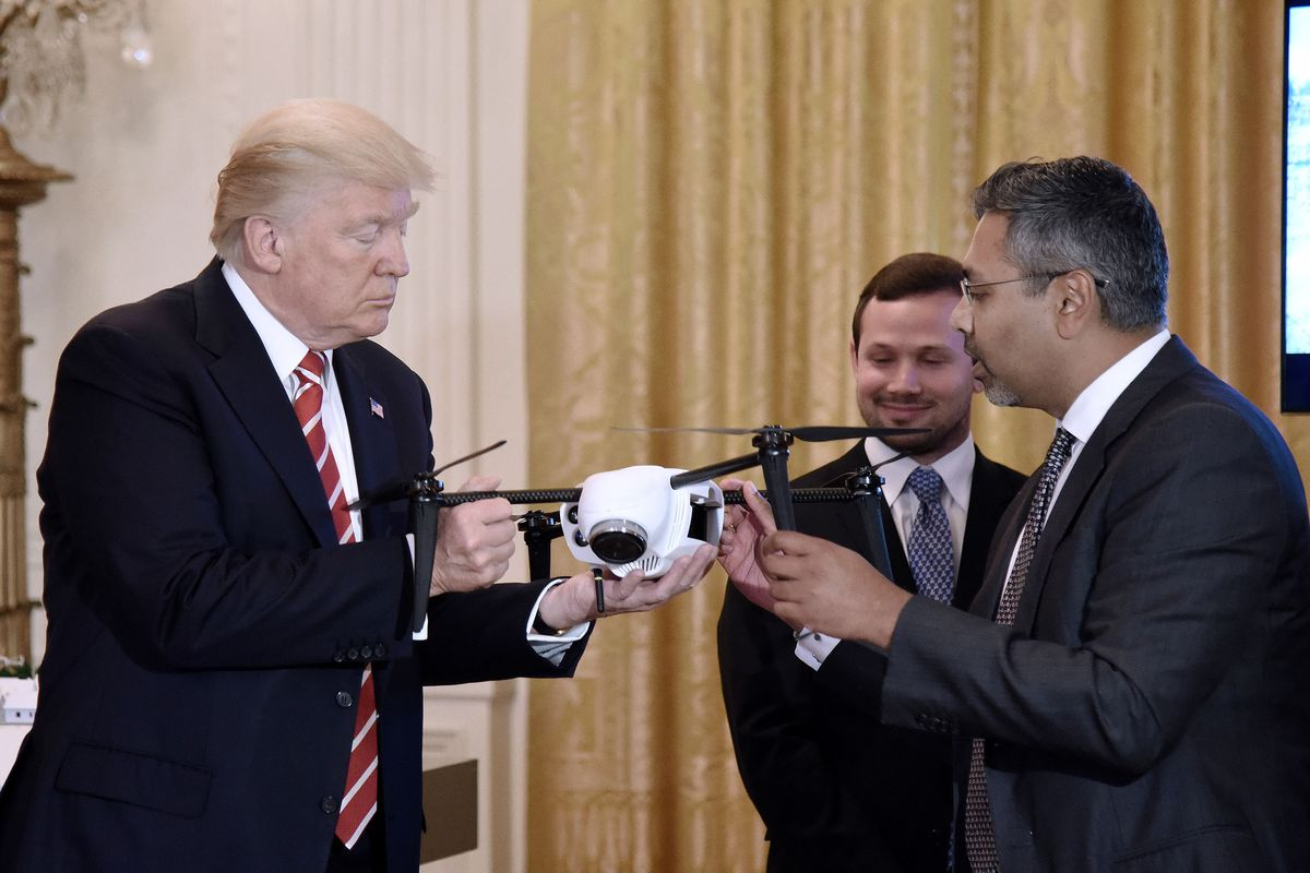 President Trump examines a quadcopter drone as Kespry CEO and Chairman George Matthew explains how it works.