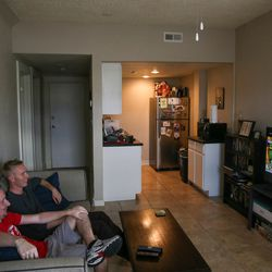 Roommates Cole Thomas, 33, and Connor Reese, 24, watch the University of Utah football game at their apartment on First Avenue in Salt Lake City on Saturday, Oct. 1, 2016.