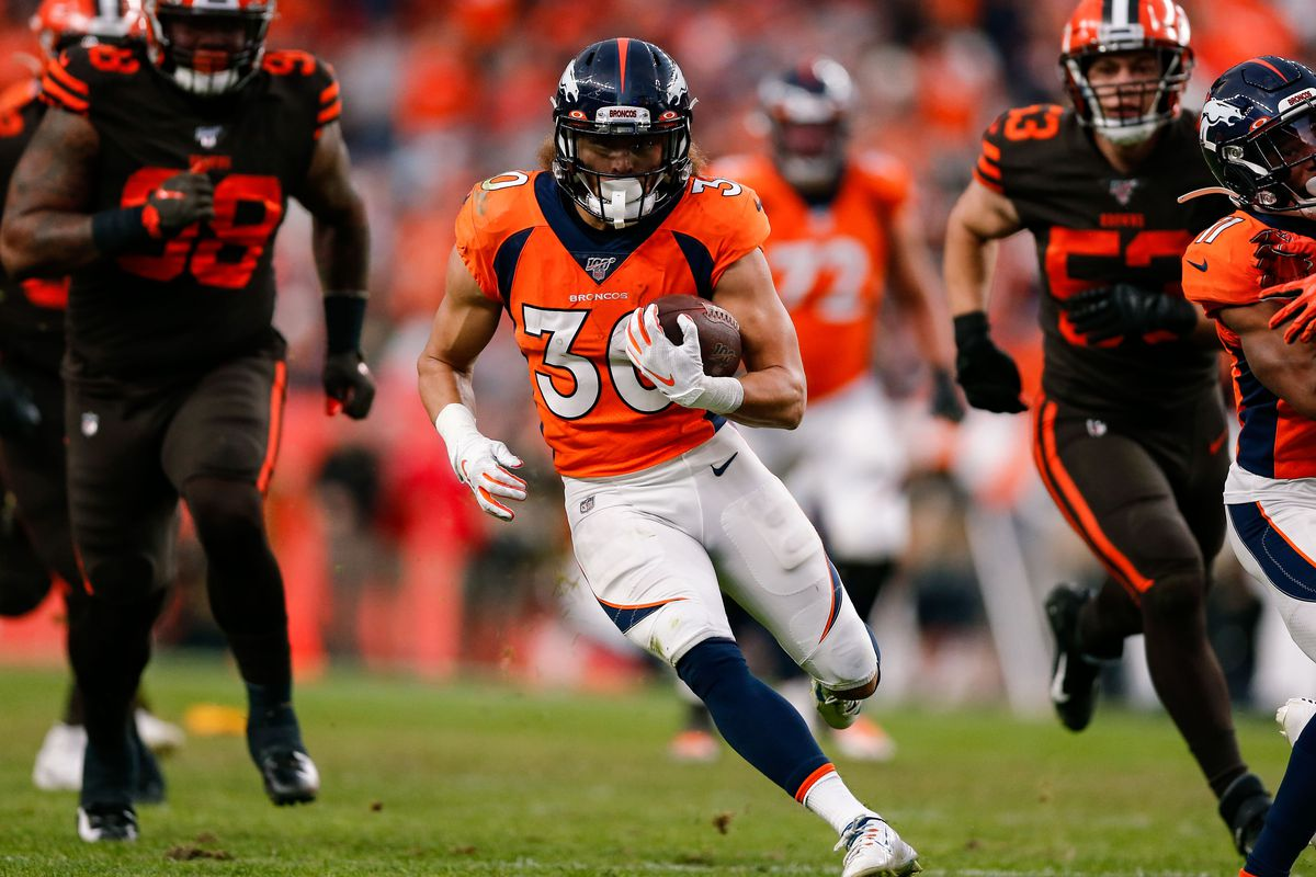 Denver Broncos running back Phillip Lindsay runs for a touchdown in the third quarter against the Cleveland Browns at Empower Field at Mile High.
