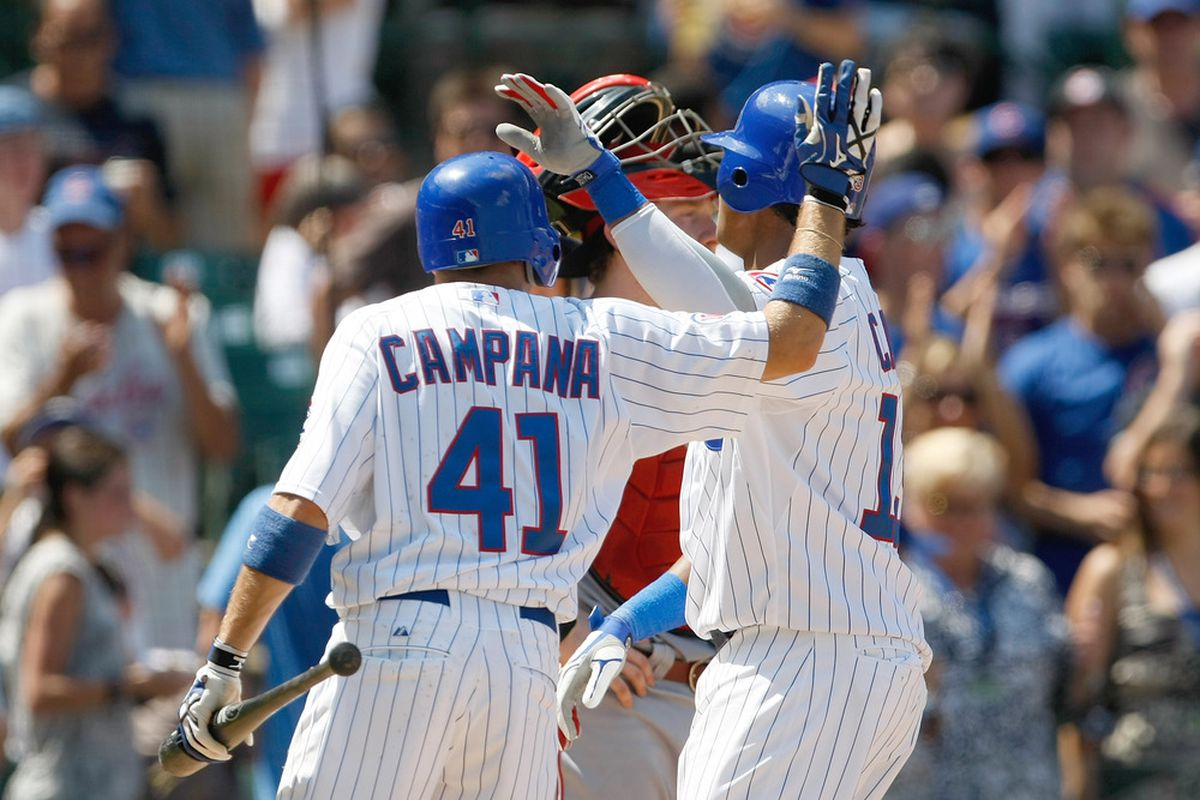 Starlin Castro of the Chicago Cubs is congratulated by Tony Campana after hitting a home run against the Cincinnati Reds at Wrigley Field in Chicago, Illinois. (Photo by Scott Boehm/Getty Images)