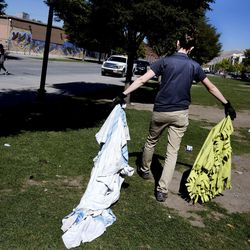 Karla Bartholomew, health scientist with the Salt Lake County Health Department, cleans up the homeless encampments on 500 West in Salt Lake City on Wednesday, Sept. 28, 2016.