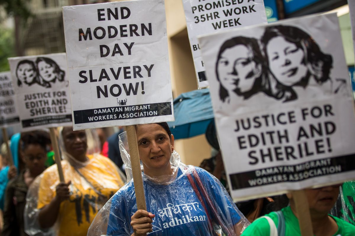 Activists march toward the German consulate during a rally to support two Filipina domestic workers in their lawsuit against a German diplomat, August 7, 2017 in New York City. Two Filipina domestic workers are suing German diplomat Pit Koehler and his wi