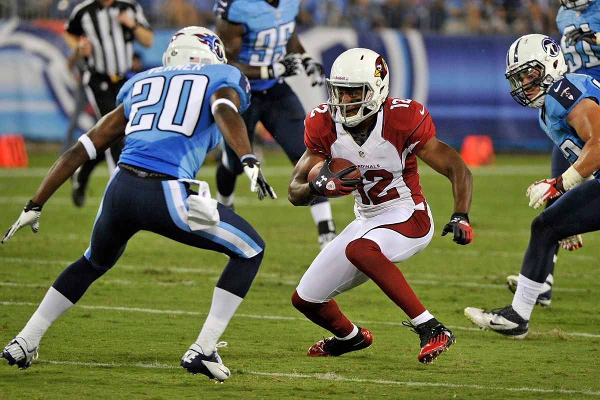 NASHVILLE, TN - AUGUST 23:  Andre Roberts #12 of the Arizona Cardinals runs toward Alterraun Verner #20 of the Tennessee Titans at LP Field on August 23, 2012 in Nashville, Tennessee.  (Photo by Frederick Breedon/Getty Images)
