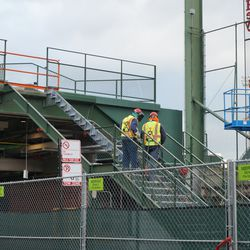 Staircase being dismantled, in the left field bleachers, next to the left field foul pole