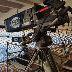 Fox Sports camera setup behind home plate in the loge level