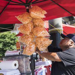 Felipe Vallarta, 58, an elotero, serves chicharrónes in Rogers Park.   Ashlee Rezin/Sun-Times