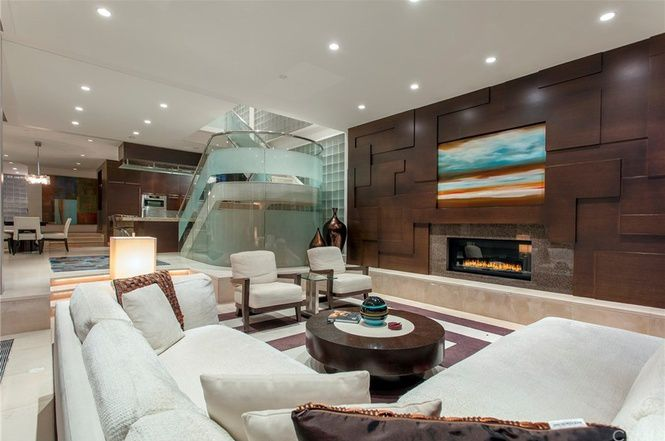 Living room with glassy staircase