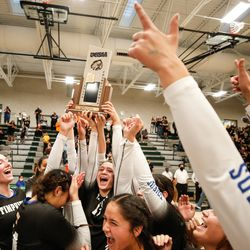 Timpview players hoist the trophy after winning the UHSAA 5A volleyball state championship game against Mountain View at Hillcrest High School in Midvale on Saturday, Nov. 7, 2020.