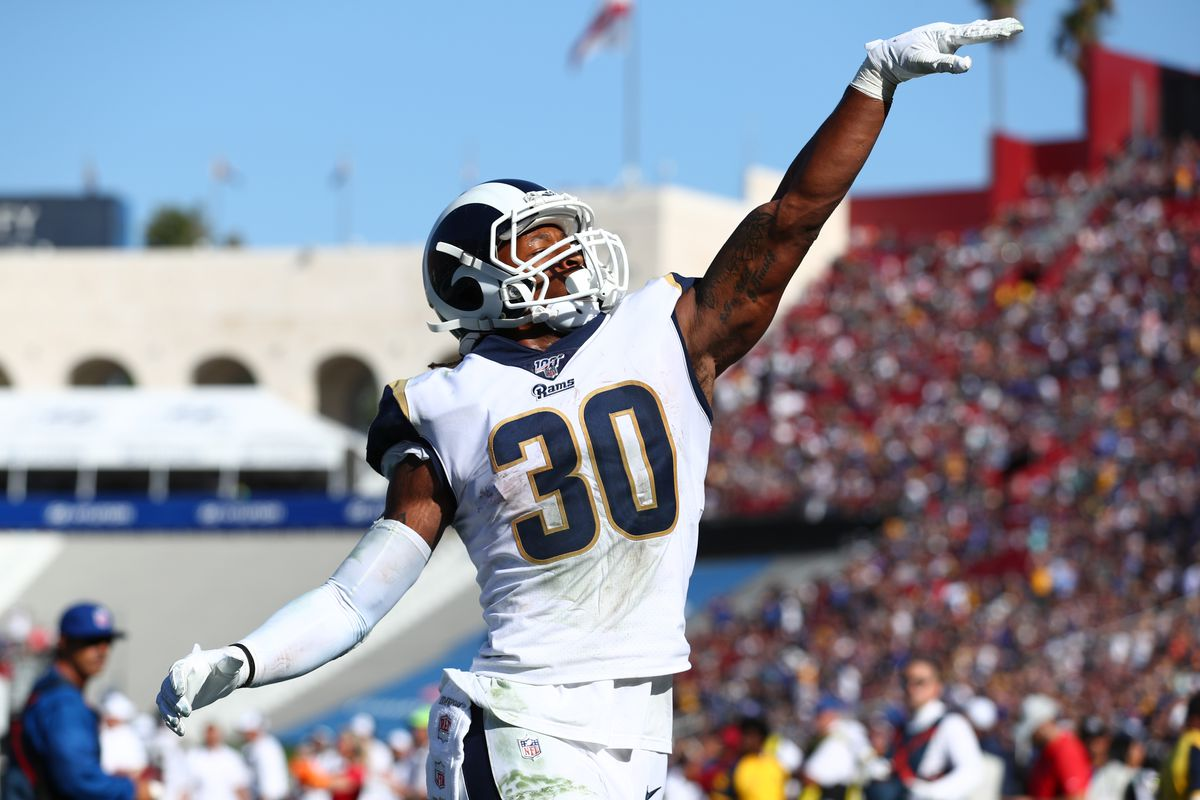 Todd Gurley #30 of the Los Angeles Rams throws the ball into the crowd after scoring a touchdown in the fourth quarter against the Tampa Bay Buccaneers at Los Angeles Memorial Coliseum on September 29, 2019 in Los Angeles, California.