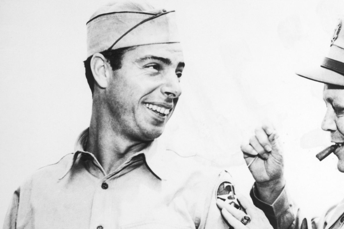 General Sews On Dimaggio'S Patch