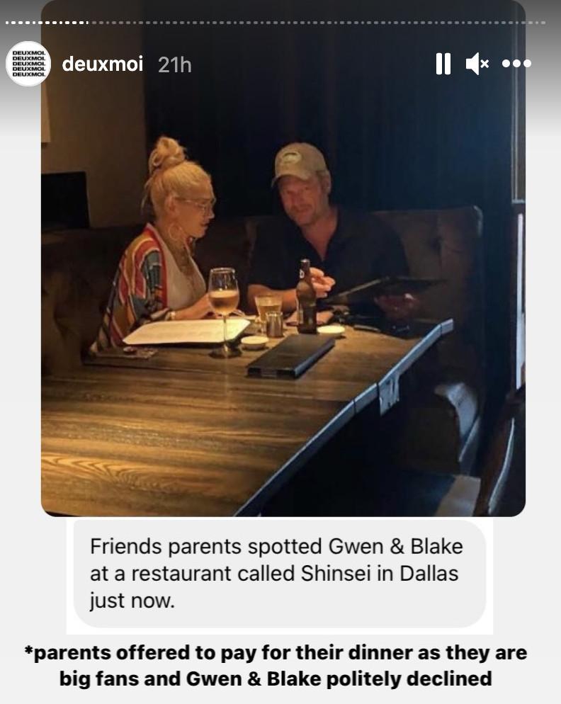 Blake Shelton and Gwen Stefani eating at a dimly lit sushi restaurant