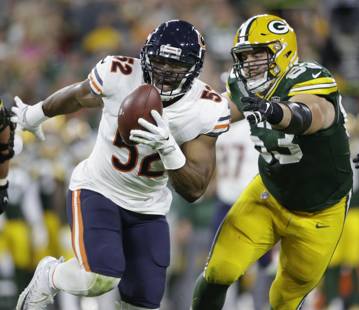 In this Sept. 9, 2018, file photo, Chicago Bears' Khalil Mack intercepts a pass and returns it for a touchdown during the first half of an NFL football game against the Green Bay Packers, in Green Bay, Wis. The Chicago Bears have a chance to tighten their