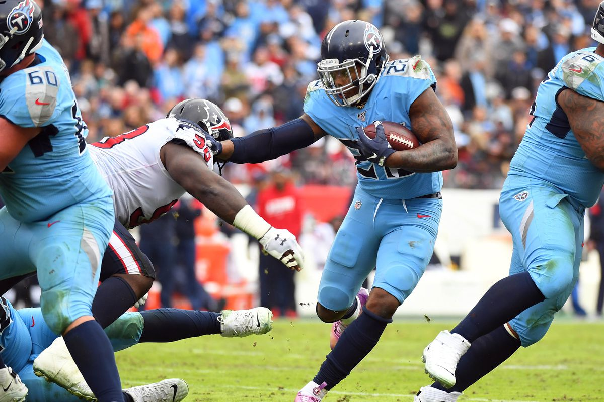 Tennessee Titans running back Derrick Henry fights off a tackle attempt from Houston Texans defensive end D.J. Reader during the second half at Nissan Stadium.