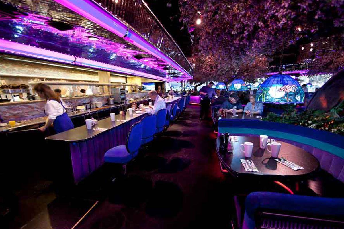 A neon-lit interior of a restaurant