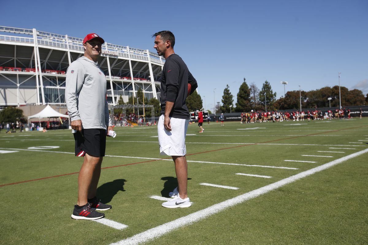 General Manager John Lynch and Head Coach Kyle Shanahan of the San Francisco 49ers talk on the field during training camp at the SAP Performance Center on August 2, 2019 in Santa Clara, California.