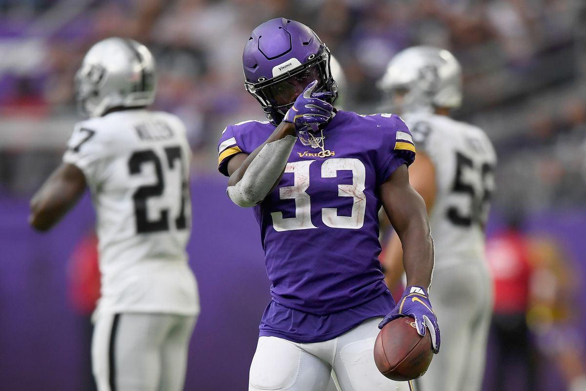 Dalvin Cook of the Minnesota Vikings celebrates a first down against the Oakland Raiders during the third quarter of the game at U.S. Bank Stadium on September 22, 2019 in Minneapolis, Minnesota.