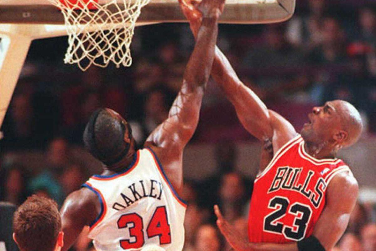 Michael Jordan of the Chicago Bulls (R) hits for t
