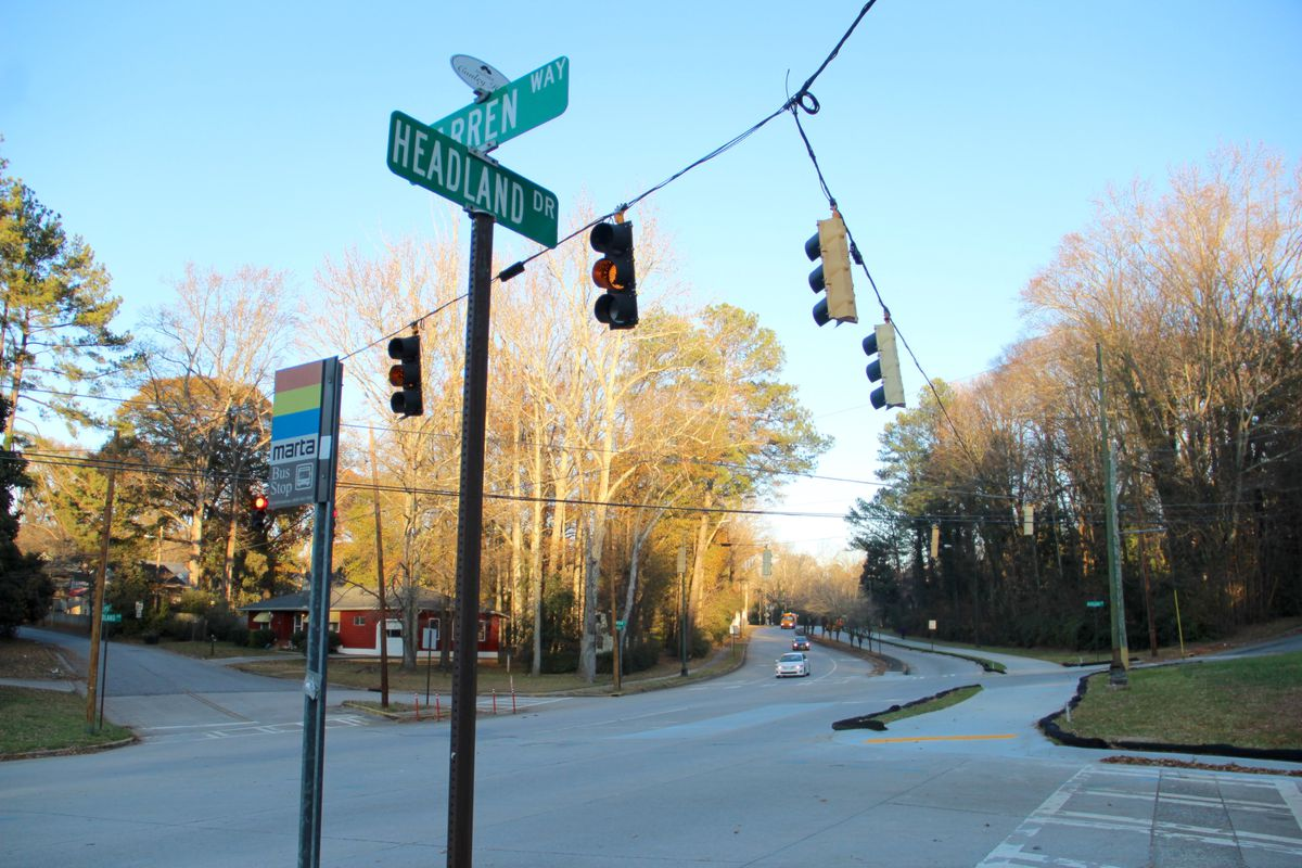 An intersection of two streets shown in winter light.