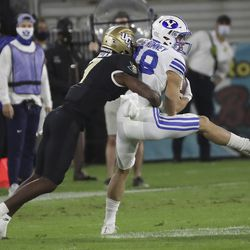 Brigham Young Cougars wide receiver Gunner Romney (18) makes a catch against UCF Knights defensive back Davonte Brown (7) during the Boca Raton Bowl in Boca Raton, Fla., on Tuesday, Dec. 22, 2020.