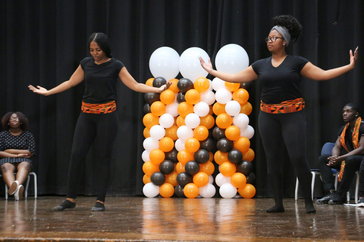 Giamarie Pottinger and Tori Wilson, 11th graders at American History High School, performed during  an event at Weequahic High School responding to the New York Times Magazine's 1619 Project.