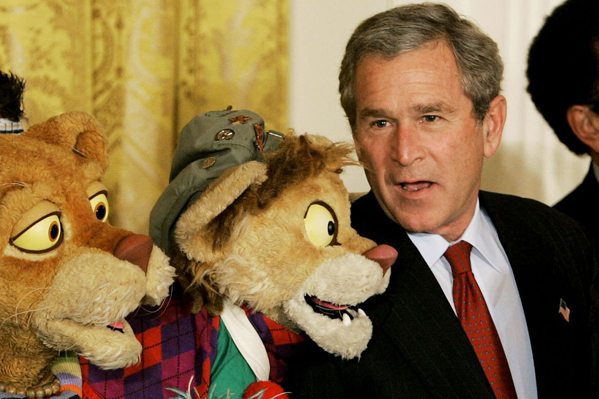 Bush with puppet.
