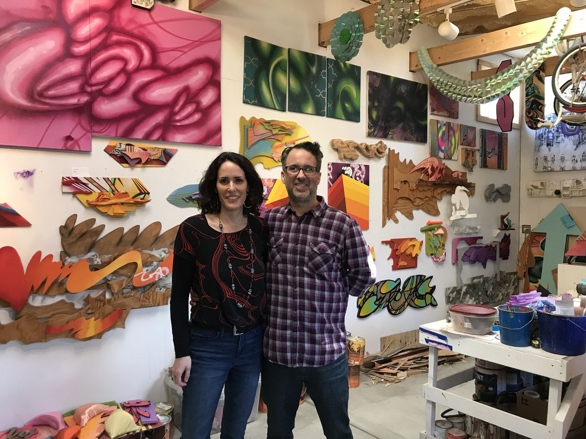 Lea Pinsky and Dustin Harris in their Evanston studio, where they do their own individual work and plan mural projects they'll do together.