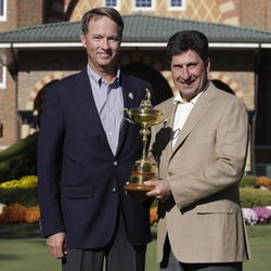 USA captain Davis Love III, left, and European captain Jose Maria Olazabal pose with the trophy at the Ryder Cup PGA golf tournament Monday, Sept. 24, 2012, at the Medinah Country Club in Medinah, Ill.