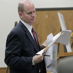 Prosecutor Chad Grunader gives closing arguments before the jury in the murder trial of former Pleasant Grove physician Martin MacNeill in Provo's 4th District Court on Friday, Nov. 8, 2013. MacNeill is charged with murder in the 2007 death of his wife, Michele MacNeill.