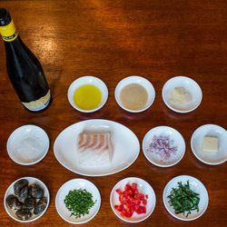 The ingredients (top row l-r) White wine, EV olive oil,  white bean puree, sliced garlic. <br> (middle row l-r) Maldon salt, Chatham cod, shallots, butter. <br> (bottom row l-r) Manila clams, chives, tomatoes, parsley.