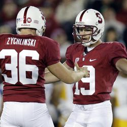 Stanford kicker Jordan Williamson (19) celebrates with teammate Daniel Zychlinski (36) after making a 46-yard field goal against San Jose State during the first half of an NCAA college football game in Stanford, Calif., Friday, Aug.  31, 2012.