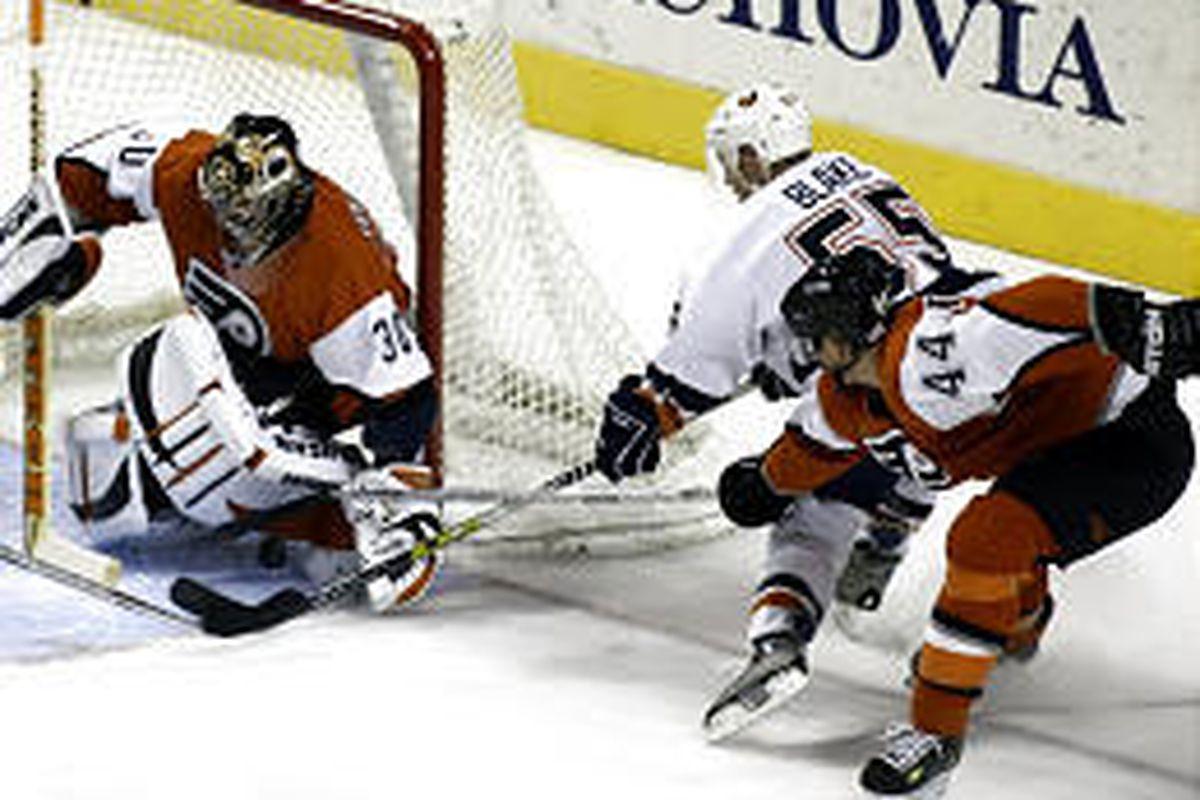 New York Islanders' Jason Blake (55) has his shot blocked by Flyers' goalie Antero Nittymaki Saturday in Philadelphia.