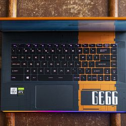There's a power button on the keyboard. There's also a crosshair key, and hotkeys that bring up the Dragon Center and the SteelSeries Engine.
