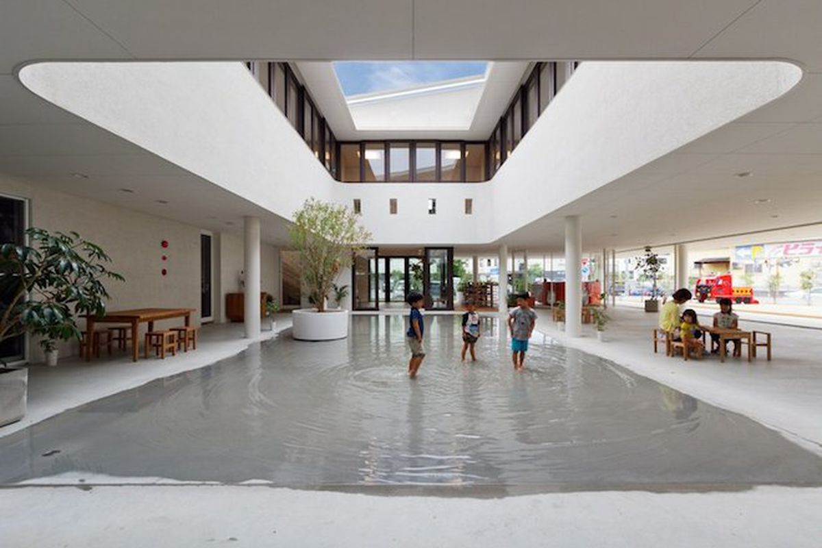 """All photos by Hibino Sekkei via <a href=""""http://www.spoon-tamago.com/2015/06/23/a-new-preschool-in-japan-designed-to-accumulate-large-puddles-when-it-rains/"""">Spoon &amp; Tomago</a>"""
