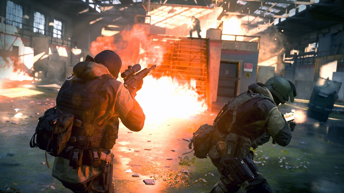 Four players engage in a firefight in a warehouse in a screenshot from Call of Duty: Modern Warfare's new Gunfight mode.