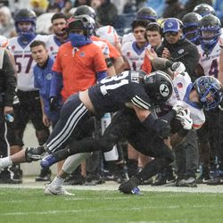 BYU linebacker Max Tooley (31) tackles a Boise State player during an NCAA college football game at LaVell Edwards Stadium in Provo on Saturday, Oct. 9, 2021.
