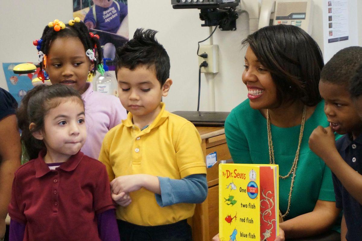 Aleesia Johnson reading to students at School 48