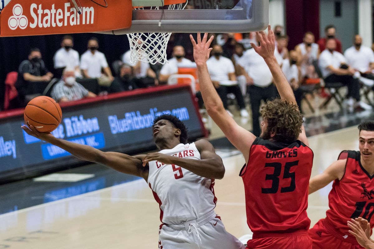 PULLMAN, WA - NOVEMBER 28: Washington State guard TJ Bamba (5) goes under the hoop for the layup during the first half of the non-conference matchup between the Eastern Washington Eagles and the Washington State Cougars on November 28, 2020, at  Beasley Coliseum in Pullman, WA.