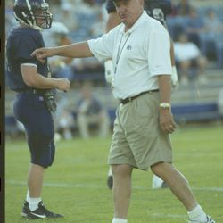 BYU head football coach LaVell Edwards instructs during a scrimmage in August 2000.