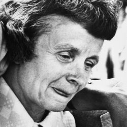Louise Bundy, mother of convicted slayer Theodore Bundy, bites her tongue as she leaves the Dade County Courthouse in Miami, Fla., July 30, 1979, where the jury voted to impose the death sentence on the 32-year-old Bundy for the murder of two sorority sisters in 1978. Judge Edward Cowart will take their recommendation under consideration and impose his sentence.