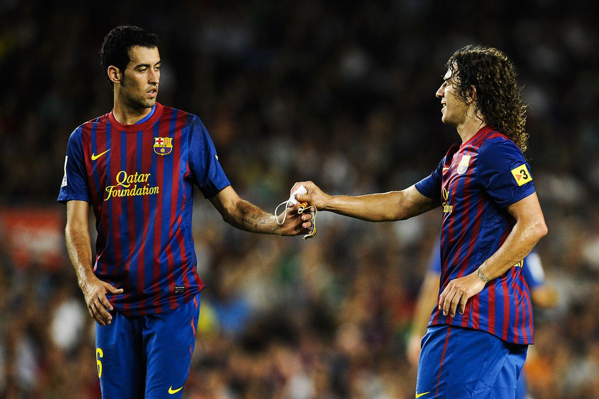 Image result for puyol Sergio Busquets and