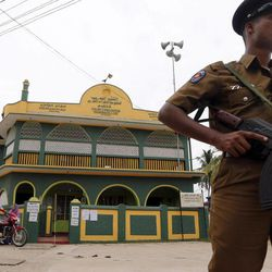 A Sri Lankan Police officer stands guard outside a polling station in Kattankudi, Sri Lanka, Saturday, Sept. 8, 2012. Sri Lankans voted Saturday in a provincial assembly election seen as a test of whether minority ethnic Tamils still want self-rule or are content with the government's development of an area devastated by a quarter-century civil war.