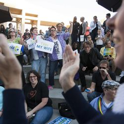 Cody Partridge rallies the crowd during a same sex marriage celebration at Library Square in Salt Lake City, Monday, Oct. 6, 2014.